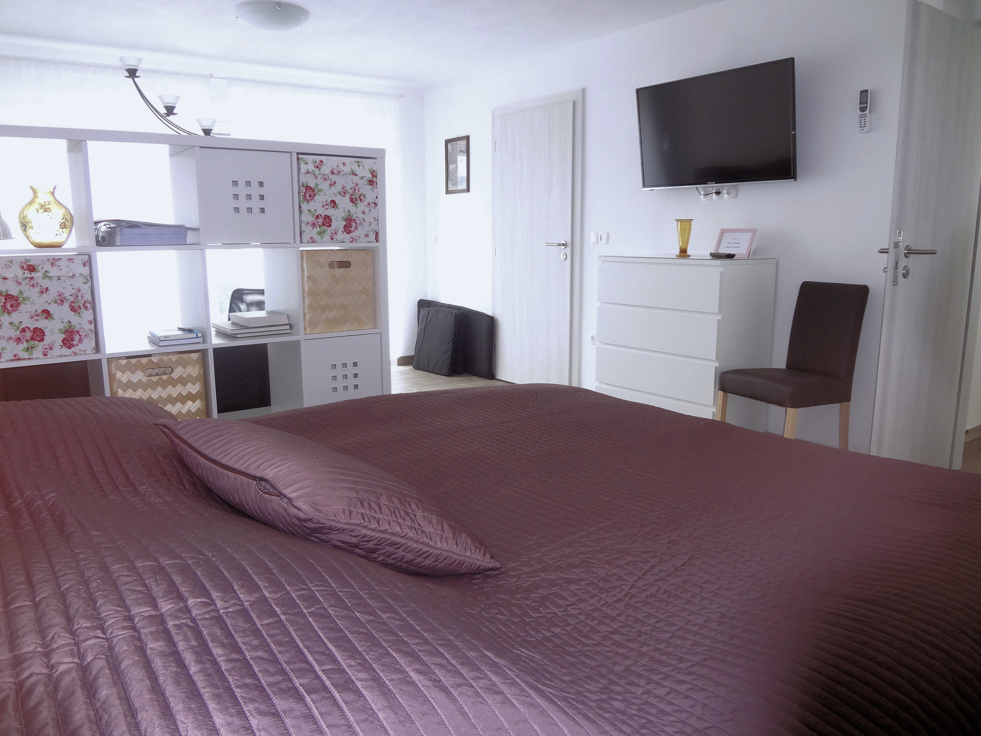 A bedroom with double bed in Apartments Fine Stay in the Gorenjska region of Slovenia