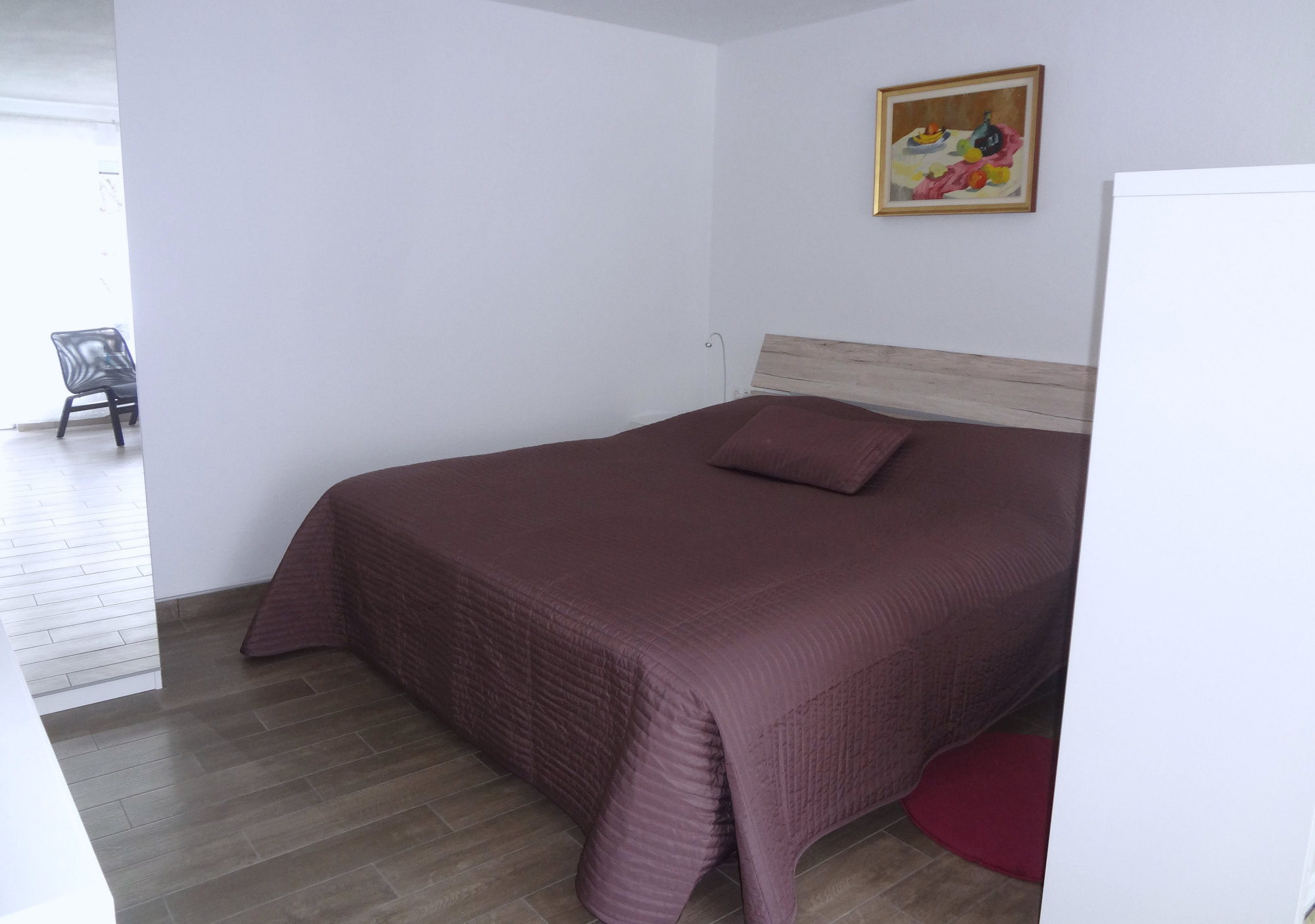 A king size double bed in the bedroom of Apartments Fine Stay in the Gorenjska region of Slovenia