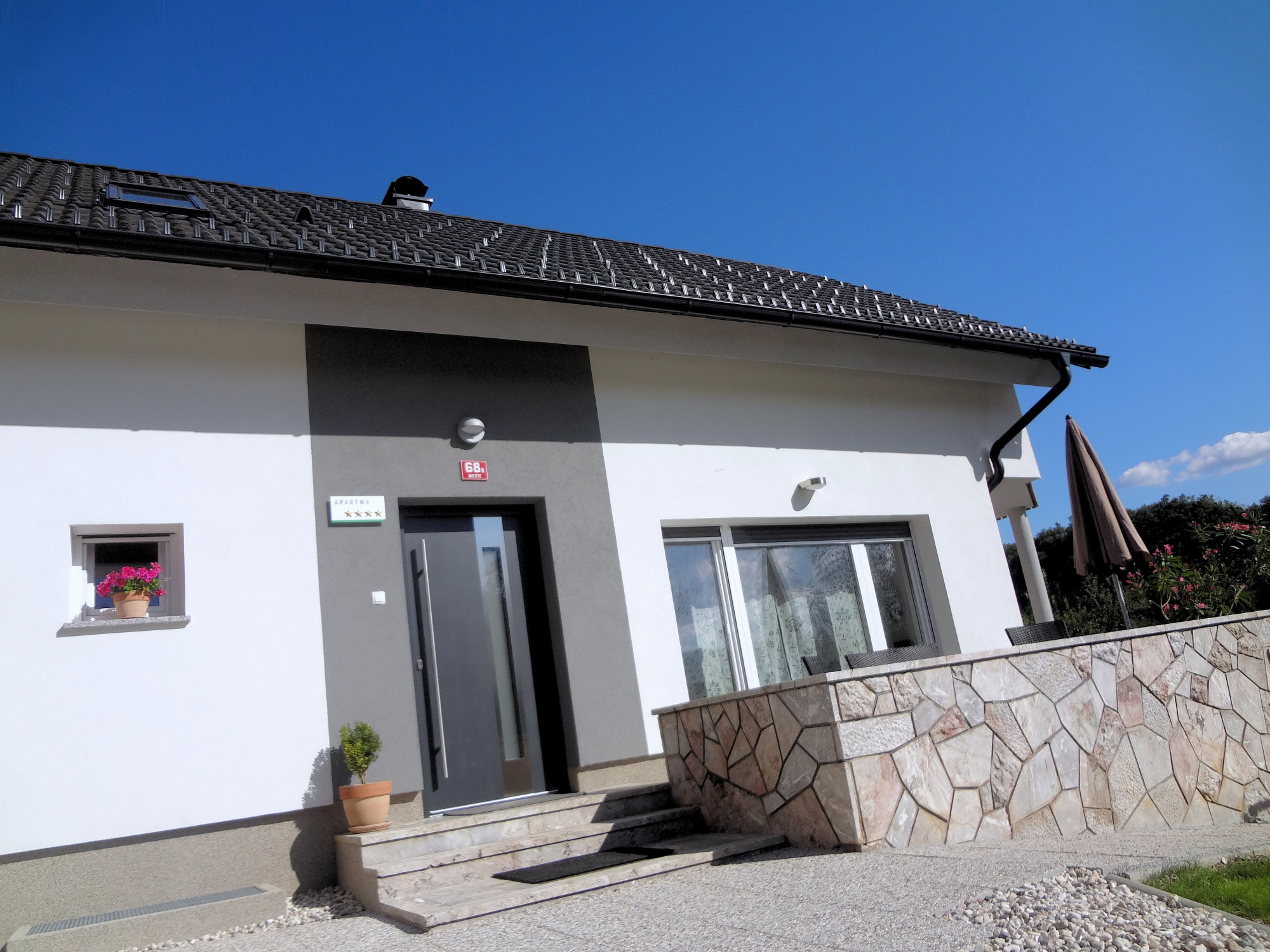 Entrance and balcony of Apartments Fine Stay in the Gorenjska region of Slovenia