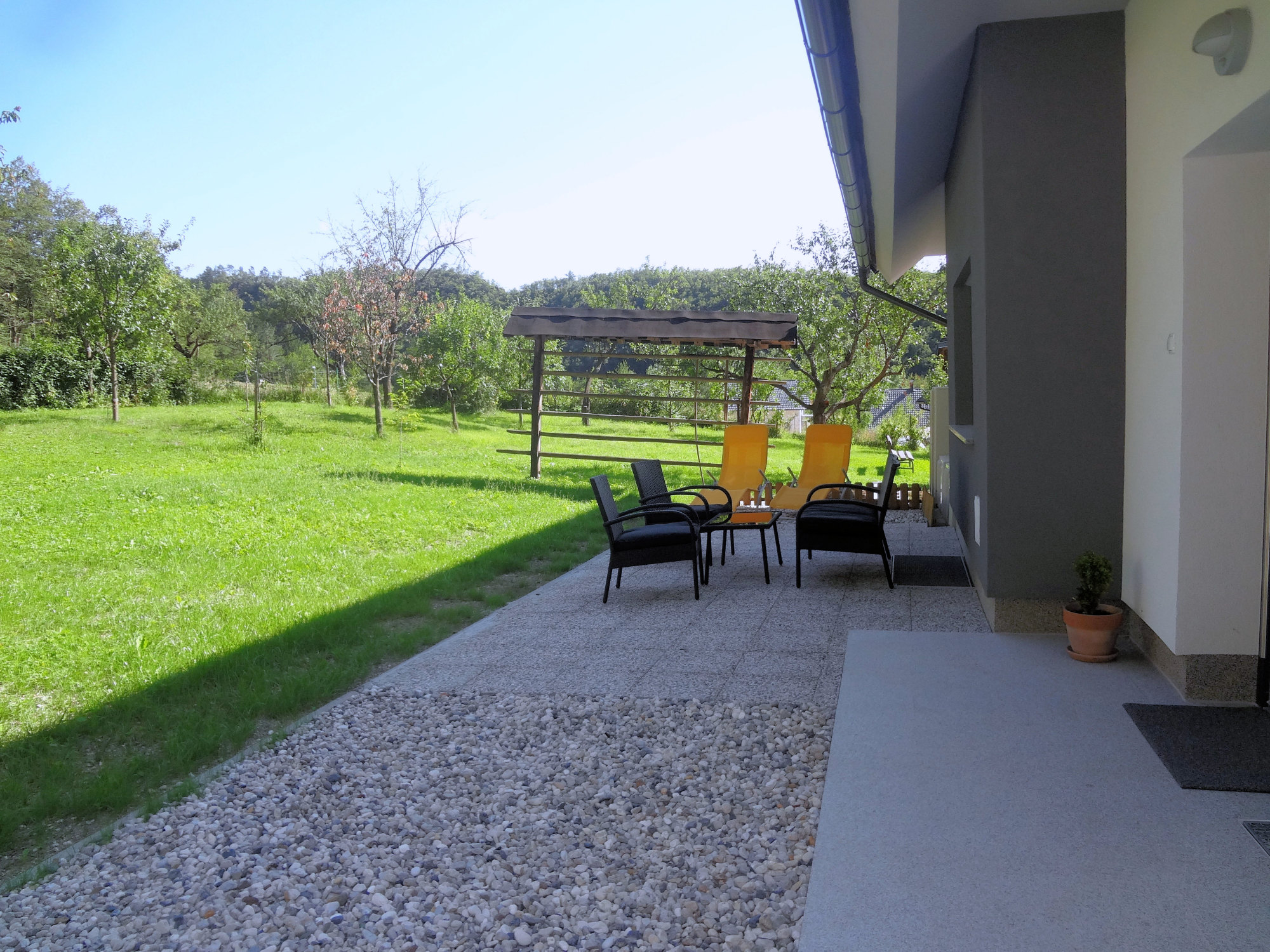 A terrace and garden behind Apartments Fine Stay in the Gorenjska region of Slovenia
