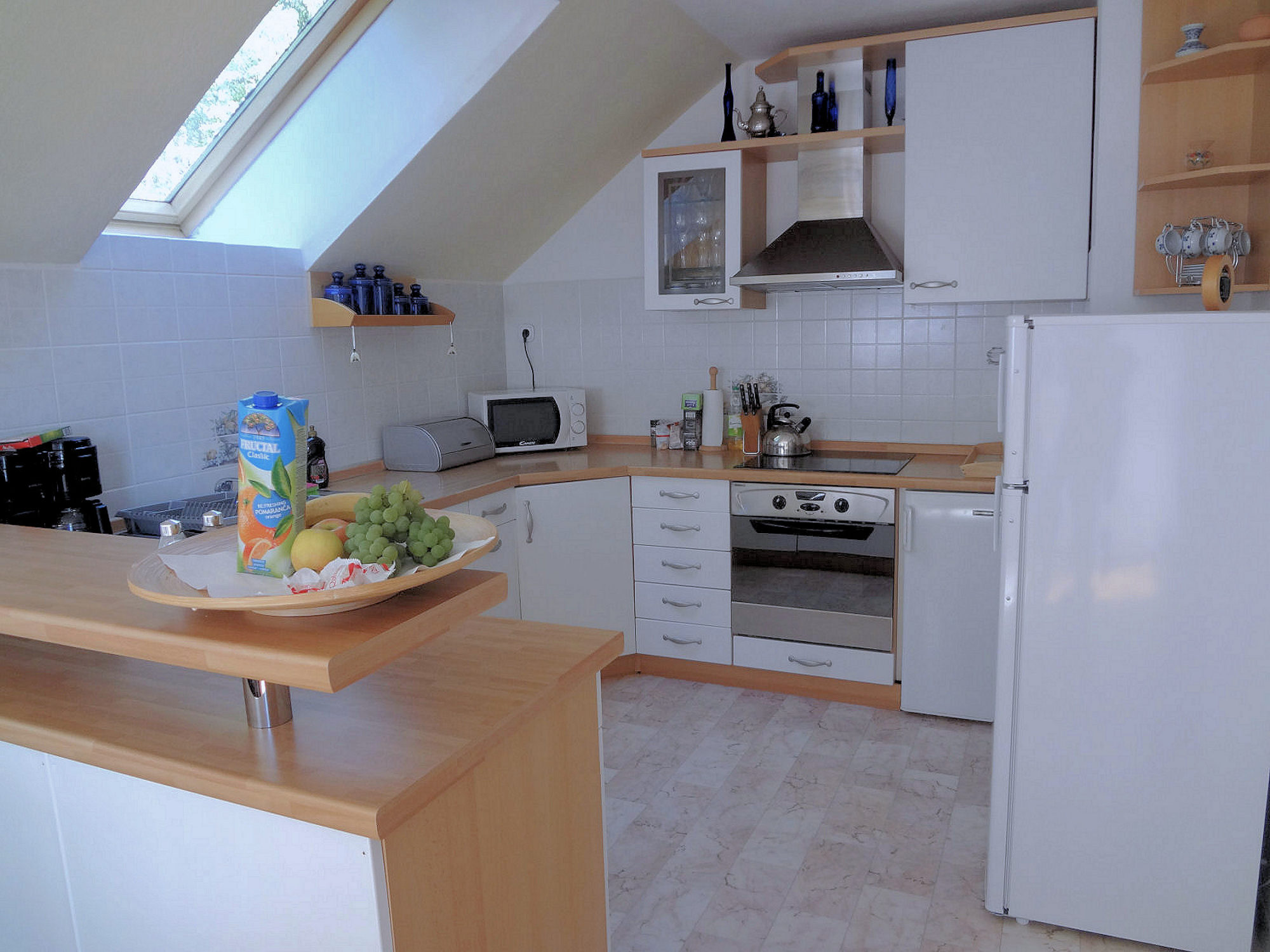 The fully equipped kitchen in Apartments Fine Stay in the Bled area of Slovenia