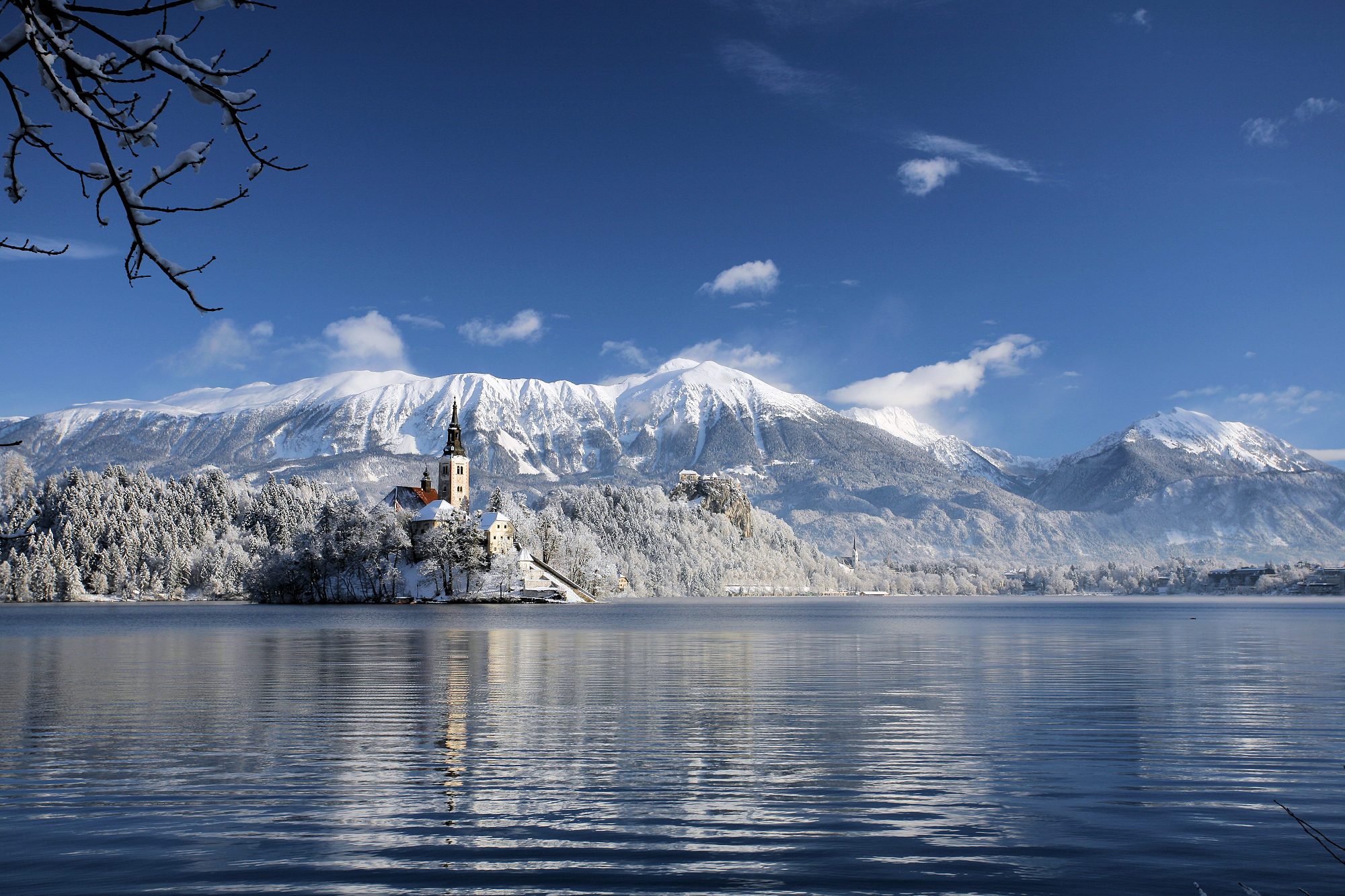 Lake Bled in winter covered with snow
