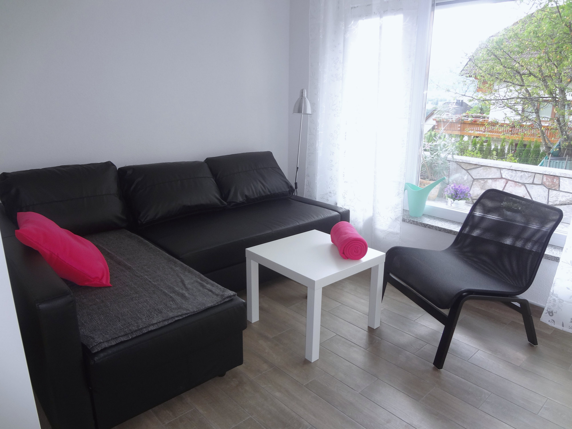 A sofa in the living area of Apartments Fine Stay in the Gorenjska region of Slovenia