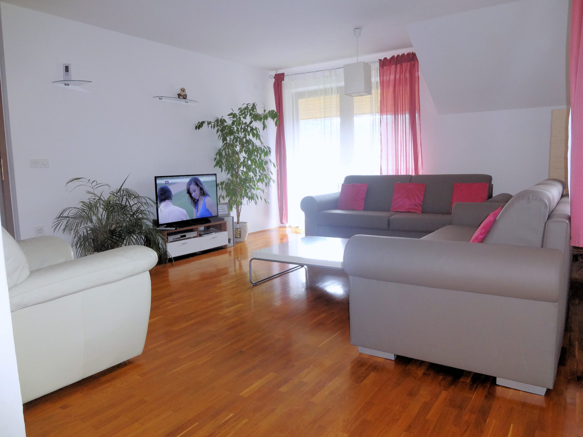 Living room with a large TV, Apartments Fine Stay in the Bled area of Slovenia
