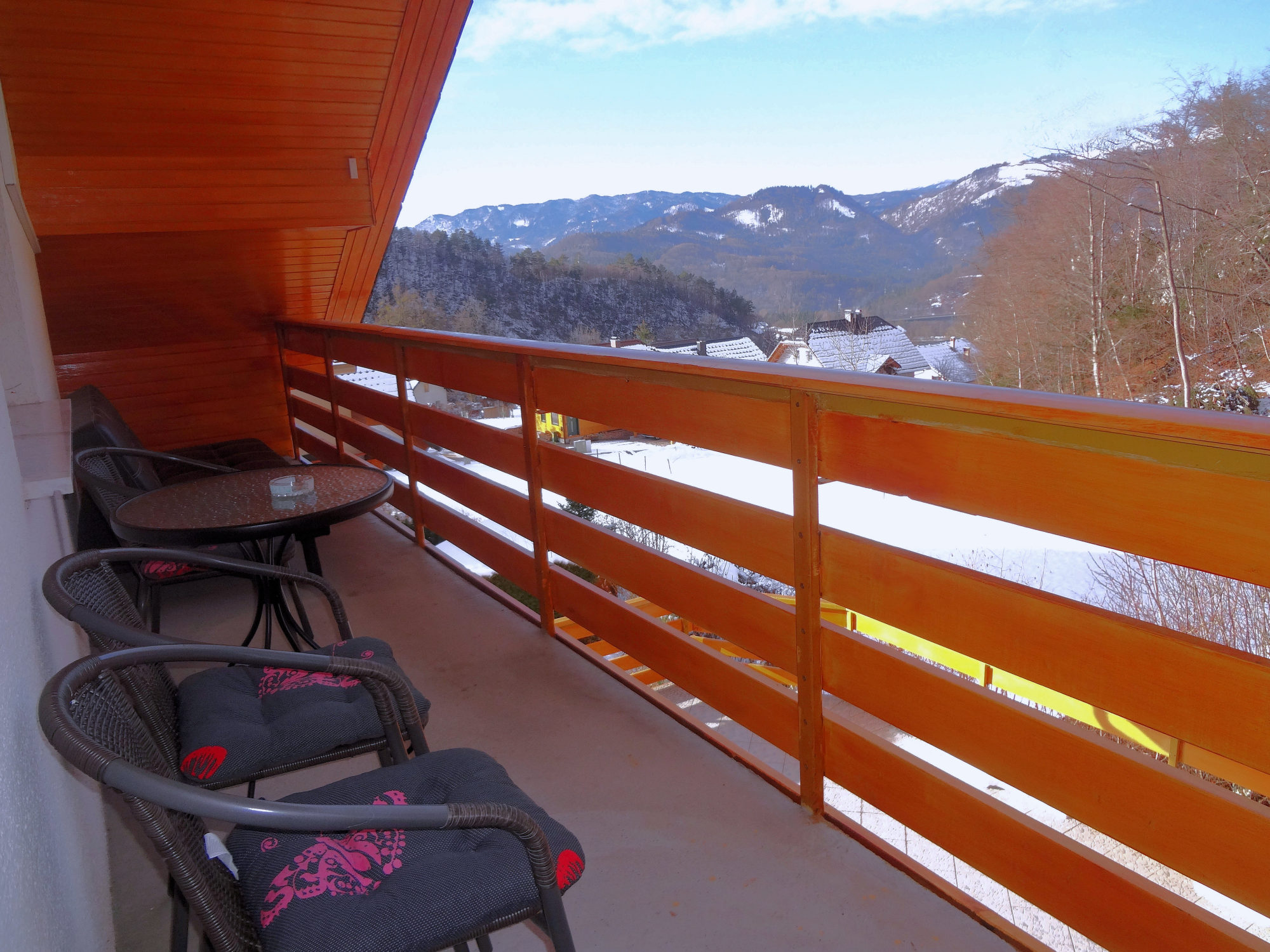 A mountain view in winter from the balcony of Apartments Fine Stay in Slovenia