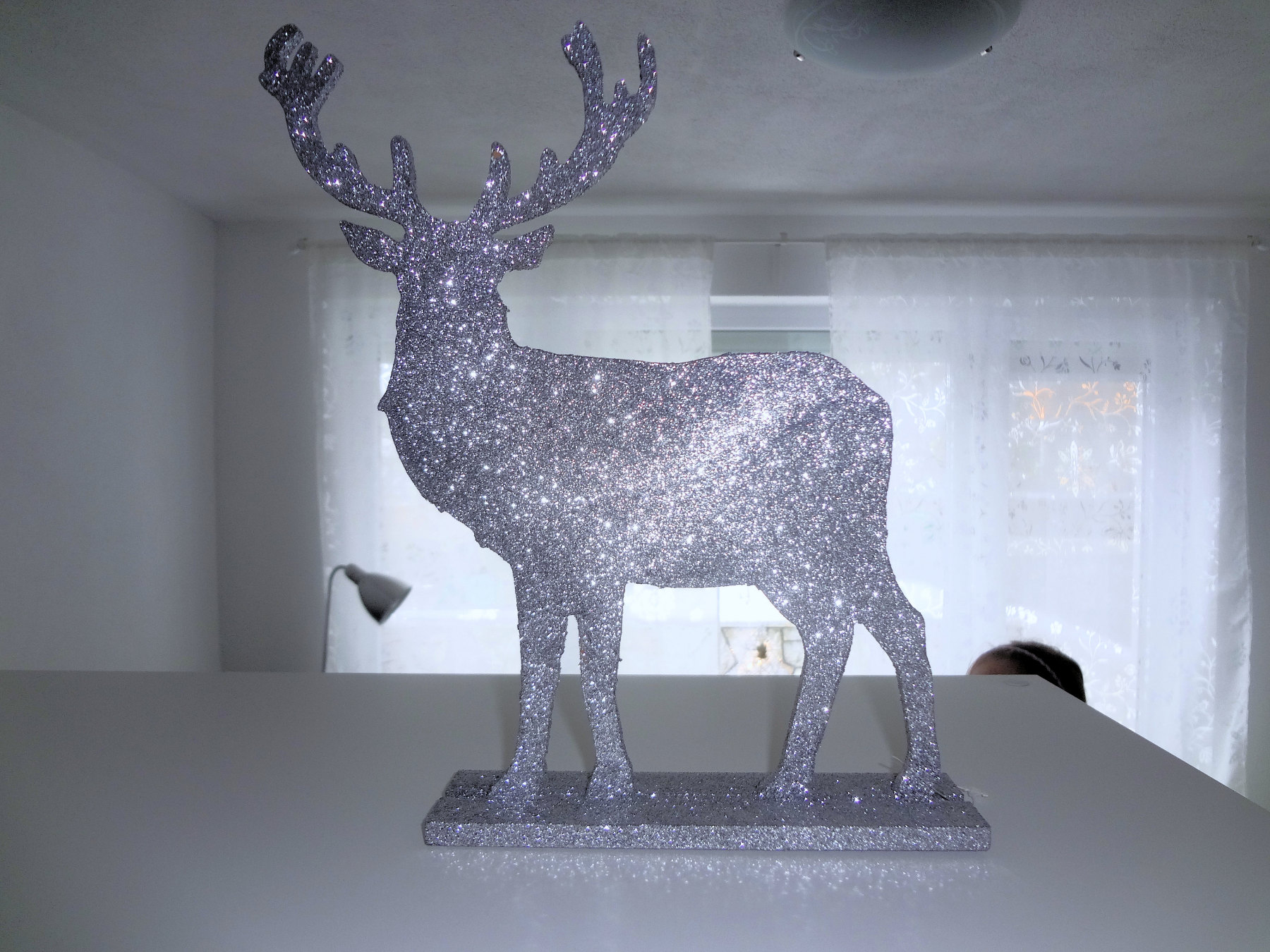 Silver Christmas Reindeer decoration in Apartments Fine Stay