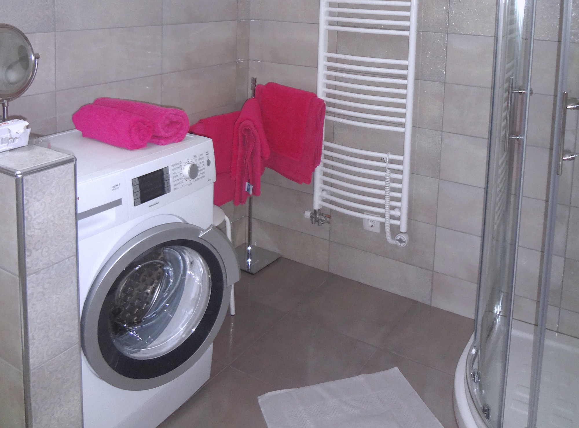 A washing machine in the bathroom of Apartments Fine Stay in the Slovenian Alps in Slovenia